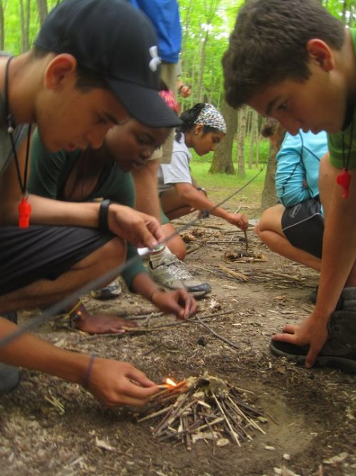 Students practice building a fire in the Delaware Water Gap.