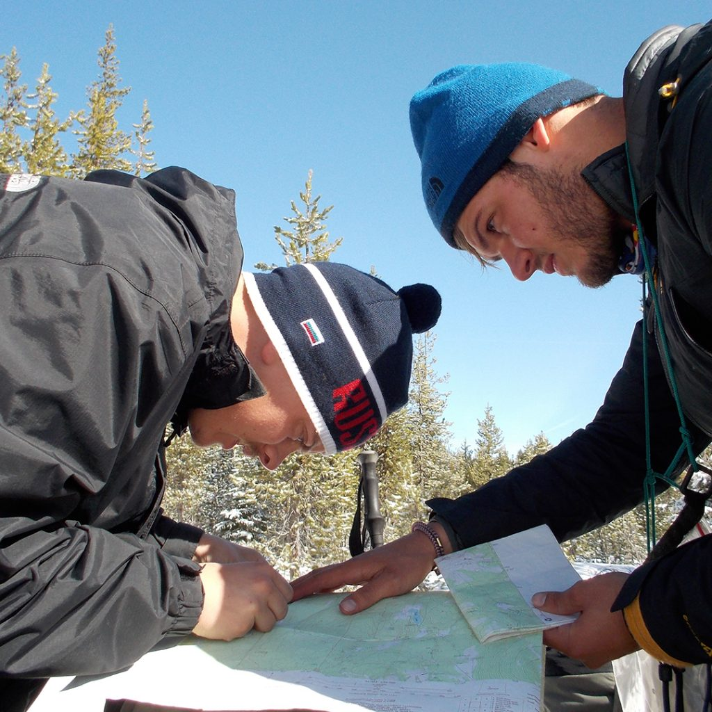 Reading a map on an Outward Bound expedition