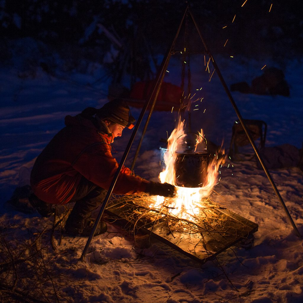 Winter cooking on a Boundary Waters Dog Sledding & Cross Country Skiing for Adults expedition