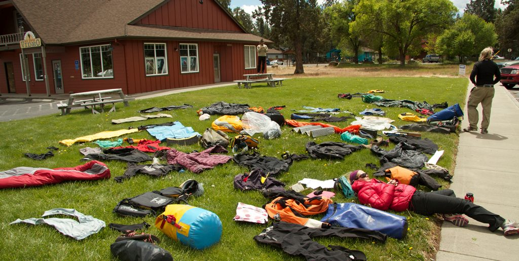 """Photo shows the prep for a """"duffle shuffle"""" before an Outward Bound expedition."""