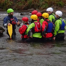 An Outward Bound Instructor reviews safety and paddling techniques with students.