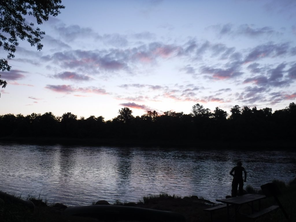 A crisp dawn breaks on the Namekagon River, right as students begin their day of travel on the St. Croix Riverway Canoeing & Rock Climbing course.
