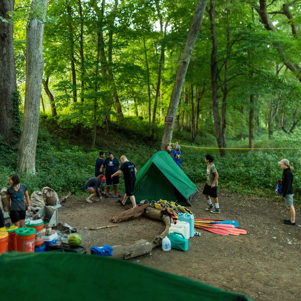 Students use teamwork and communication to set up camp for the night. Photo by Ryan Harris.
