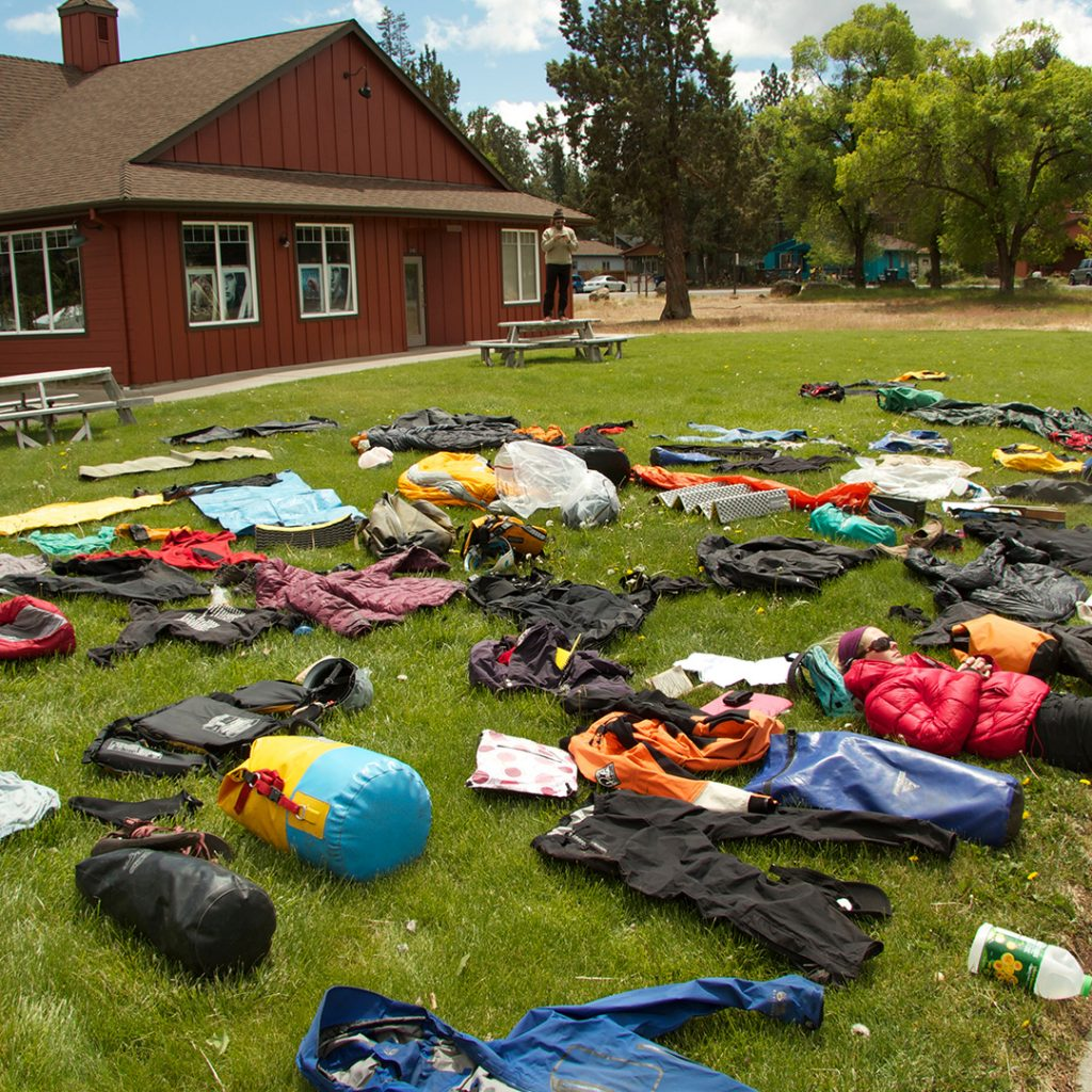 "Photo shows a typical ""duffle shuffle"" where students get their packs ready for their expedition."