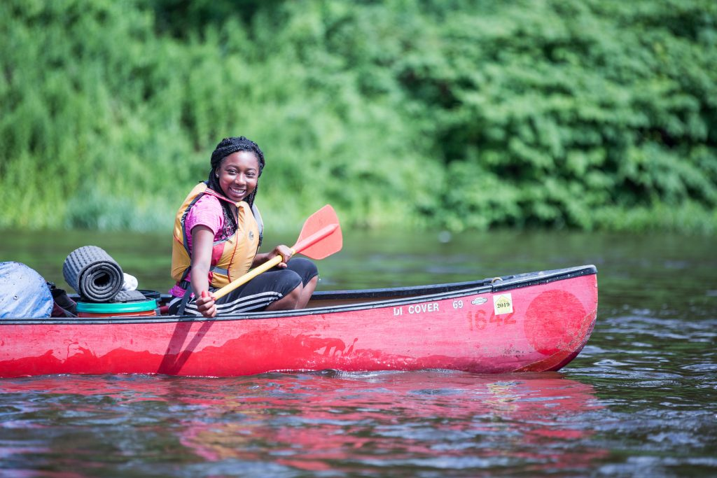 Photo shows a student on the Water Gap Canoeing for Grieving Teens expedition.