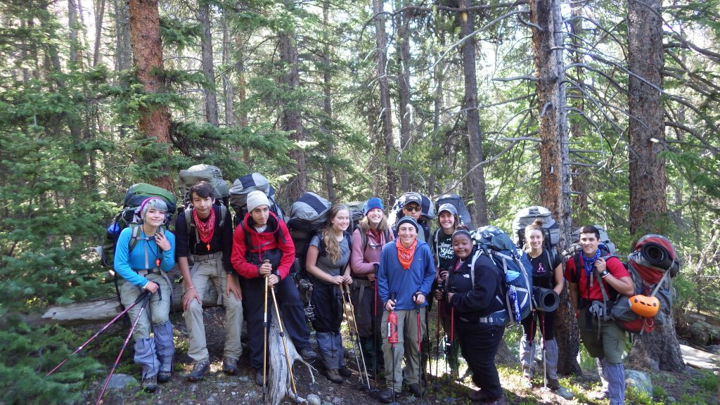 Photo shows a crew on the Colorado Rockies Alpine Backpacking for Grieving Teens expedition, courtesy of Yun Chang.