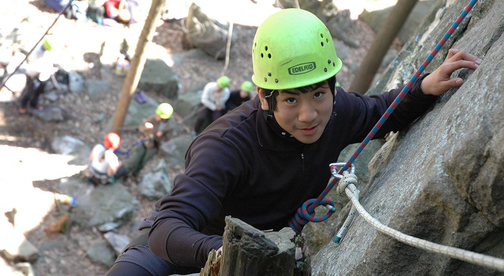 Photo shows a student on the Delaware Water Gap Backpacking & Rock Climbing for Grieving Teens expedition.