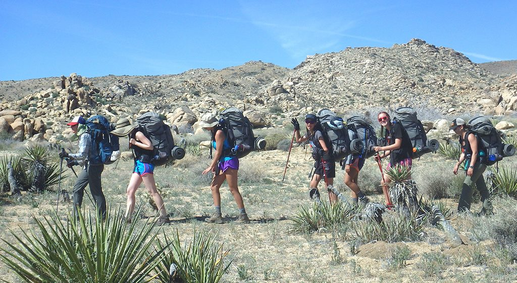 Photo shows Outward Bound students backpacking in Big Bend, Texas. By Emma Rapp.