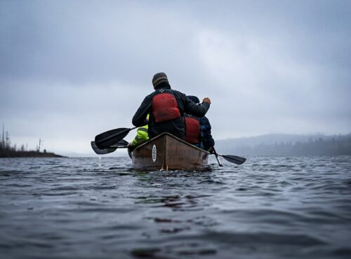 Students canoeing on expedition.