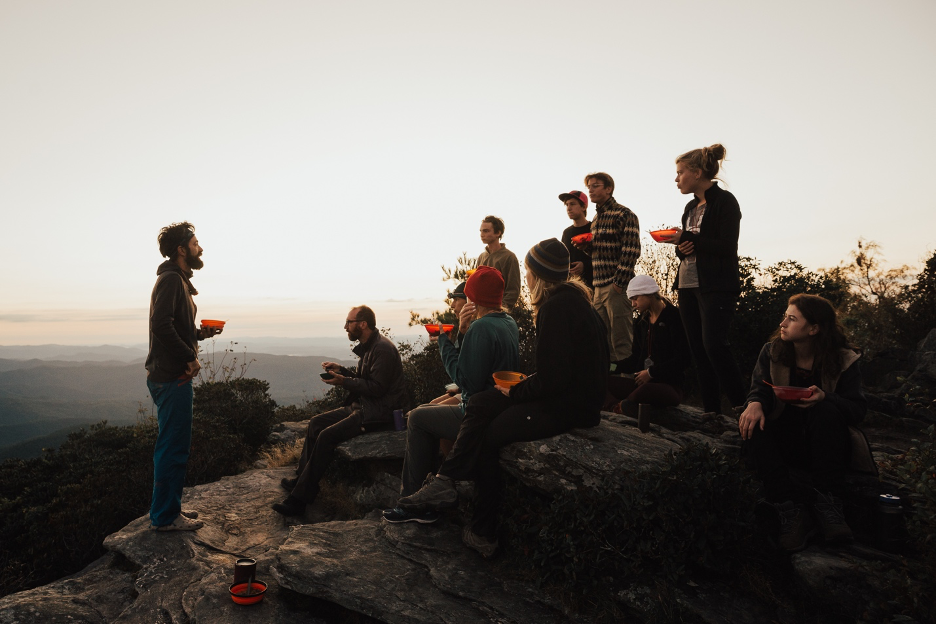 Sharing a meal on an Outward Bound course