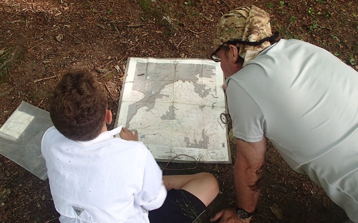 families learn navigation skills on outdoor trip