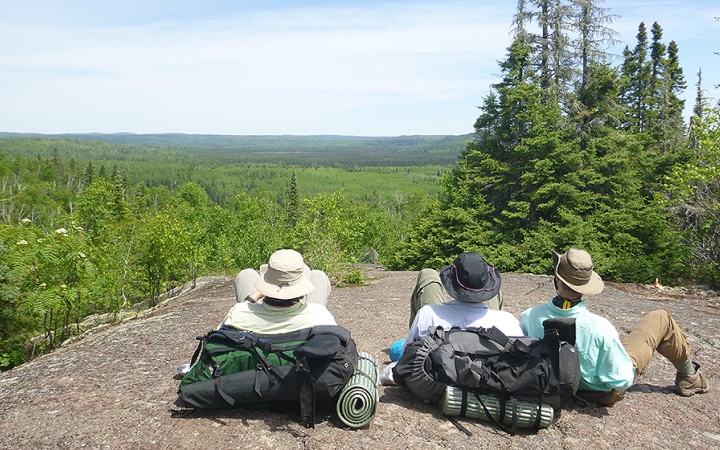 adults backpacking trip on lake superior