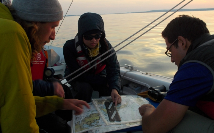 adults navigate sailing course in maine