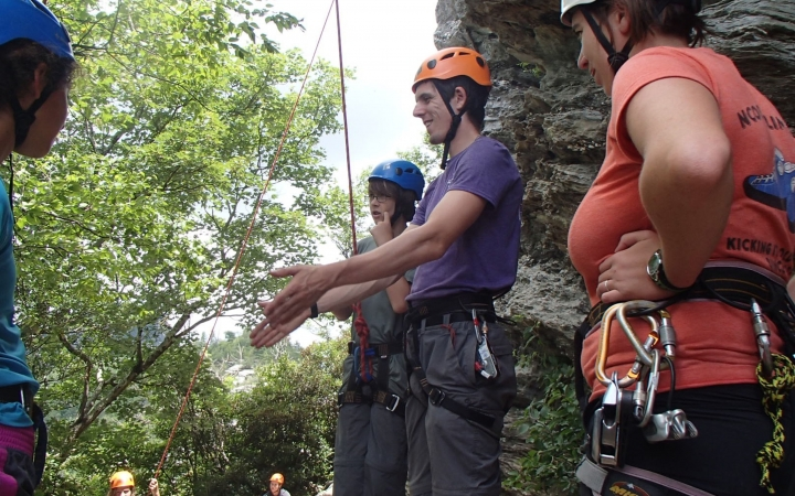 high school students learn rock climbing skills in north carolina