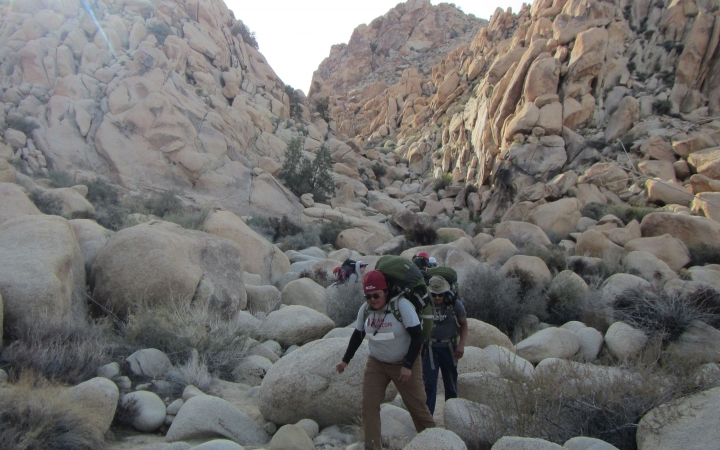 adults escape on backpacking trip in joshua tree