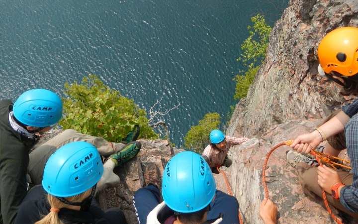 teens rock climbing trip in boundary waters
