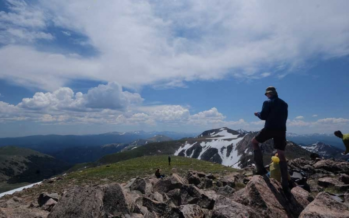 young adult backpacking trip in colorado rockies
