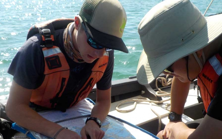adults learn navigation skills on sailing expedition in florida