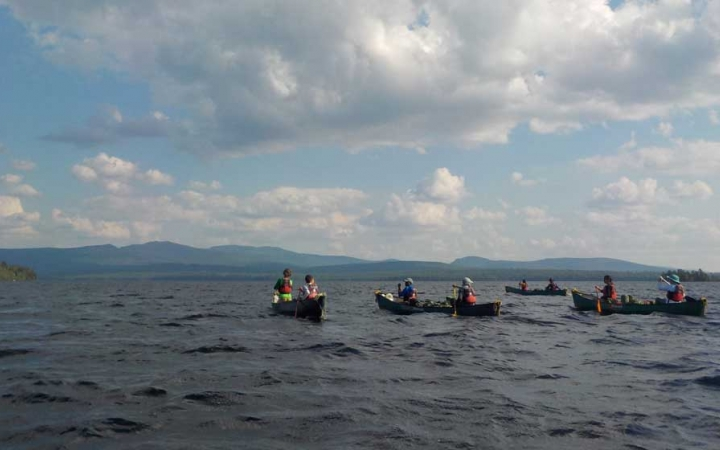 teens on group canoeing course