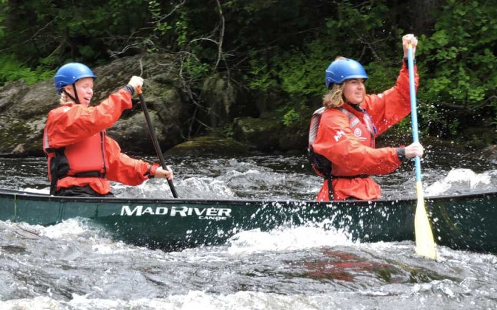 teens whitewater canoeing