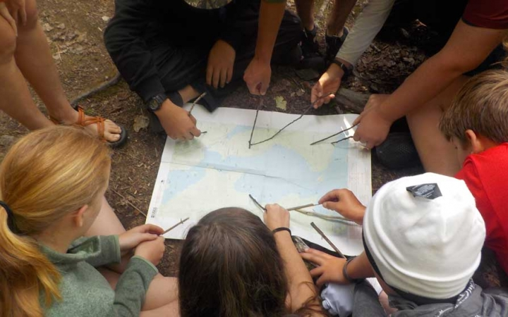 teens learn map skills on canoeing expedition