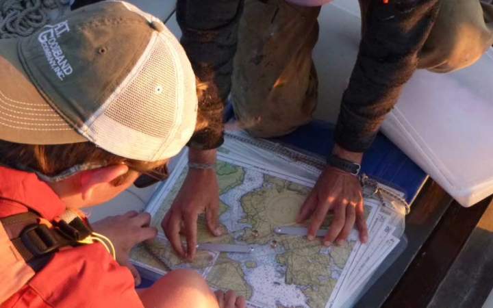 boys learn map skills while sailing