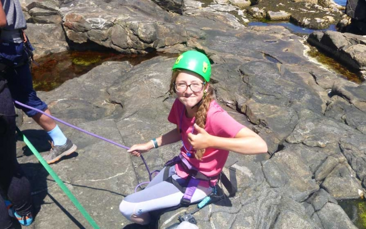 girls learn to rock climb in maine