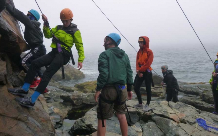 young teens learn rock climbing in maine