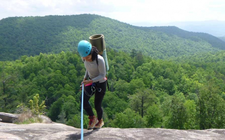 young adults rock climbing camp