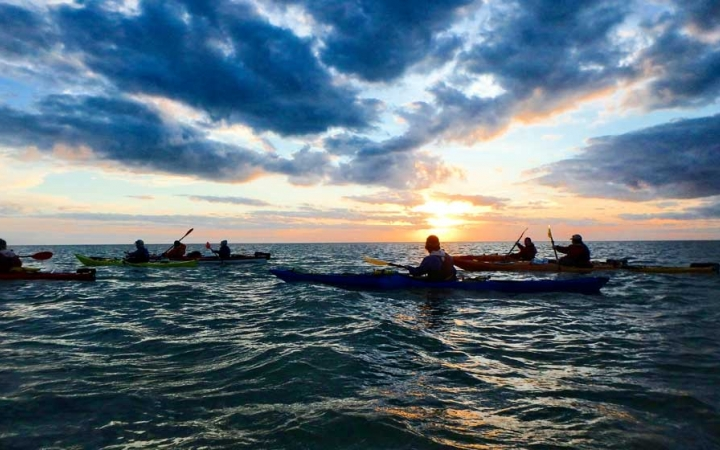 adults unplug on kayaking trip in outer banks