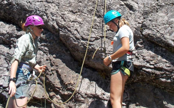 girls learn rock climbing skills