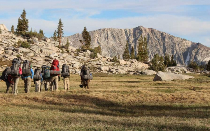 boys learn backpacking skills on outdoor course