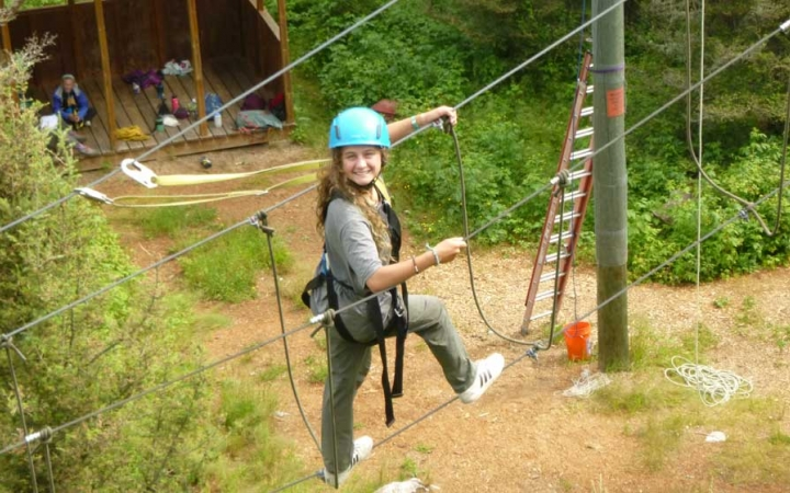 girls build confidence on ropes course