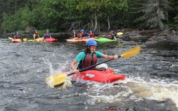 struggling teens navigate whitewater kayaks
