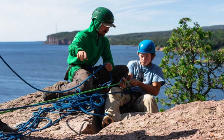 teens learn rock climbing skills in minnesota
