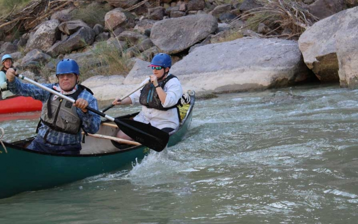 adults unplug on canoeing course