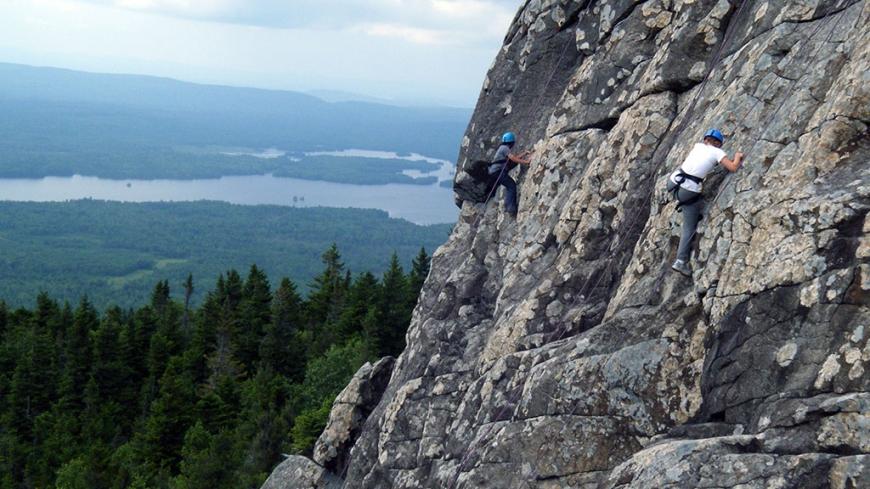 Rock climbing during a Maine Wilderness Instructor Development Course